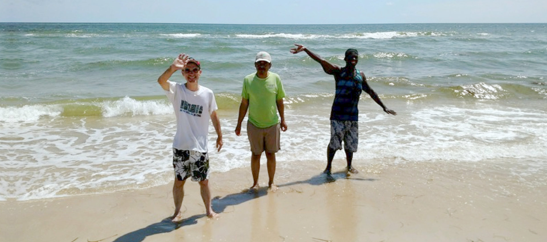 three men on a beach