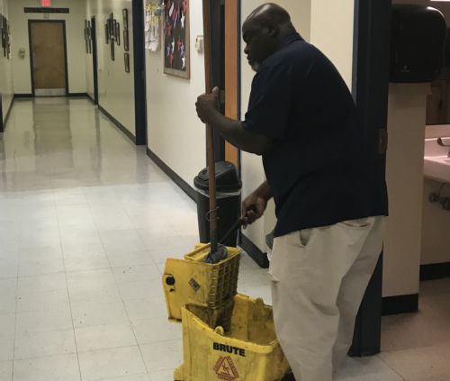 Man cleaning the lobby